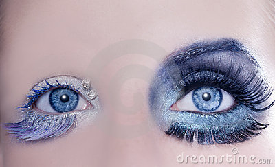 Asymmetrical blue eyes makeup macro closeup silver
