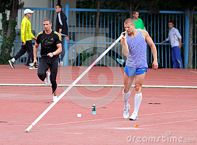 Athlete compete in pole vault Editorial Stock Image