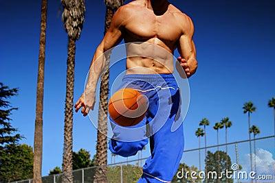 Athlete dribbling basketball