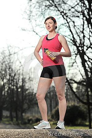 Athlete female posing outside