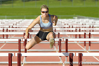 athlete jumping over hurdles stock images image 17419204
