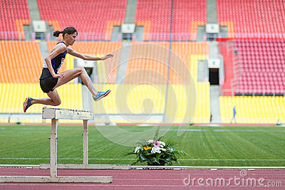 The athlete jumps to overcome an obstacle Editorial Stock Photo