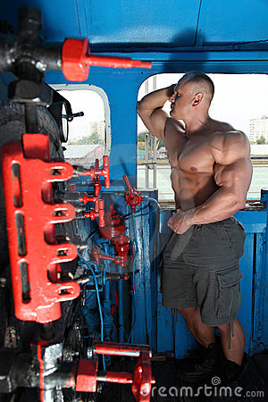 Athlete in locomotive cabin full body