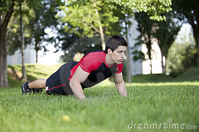 Athlete man making pushups