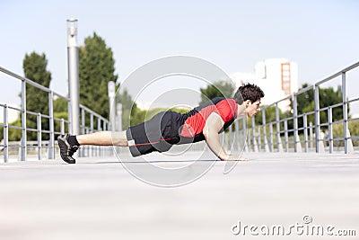 Athlete man making pushups