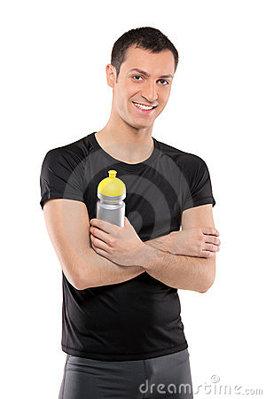 Athlete man posing with a plastic bottle