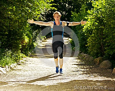 Athlete Running with Arms Outstretched