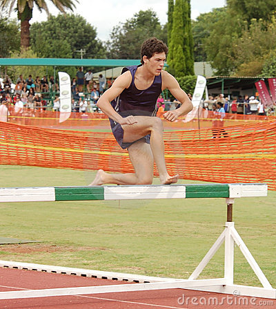 Athlete running steeplechase
