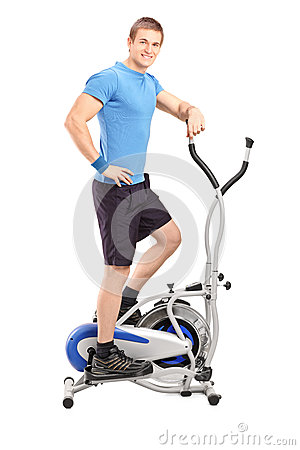 Athlete standing on a cross trainer machine