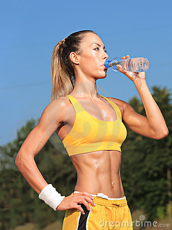 Athlete woman drinking water