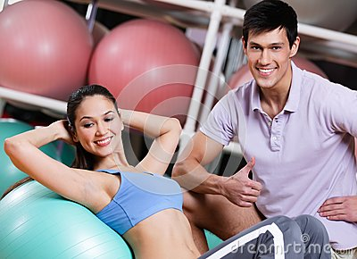 Athlete woman exercises in fitness gym