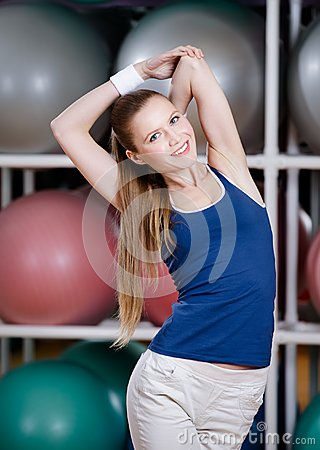 Athlete woman stretching herself