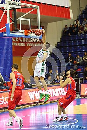 Athlete from Zalgiris team throws ball into basketball hoop Editorial Stock Photo