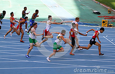 Athletes on the 4 x 100 meters relay race Editorial Stock Image