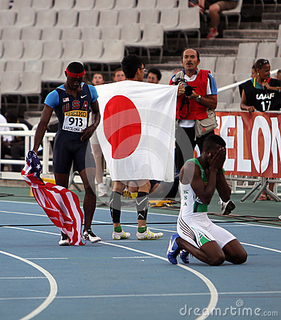 Athletes after the 400 meters hurdles final Editorial Stock Photo