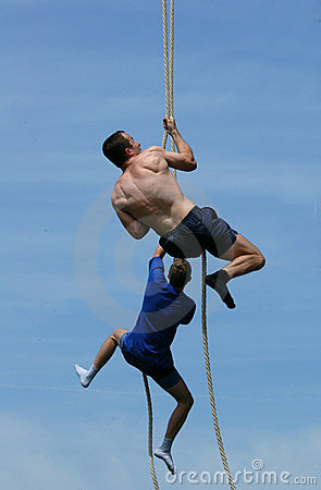 Athletes Climbing Up the Rope