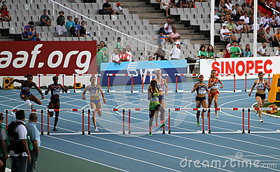 Athletes compete in the 400 meters hurdles final Editorial Photo