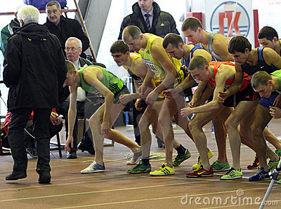Athletes line up at the start Editorial Stock Photo