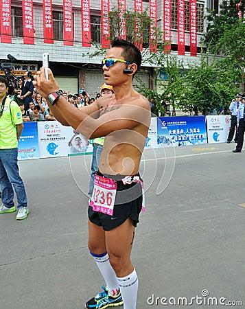 Athletes take photos Editorial Stock Photo