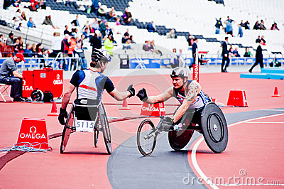 Athletes on wheelchairs shaking hands Editorial Photography