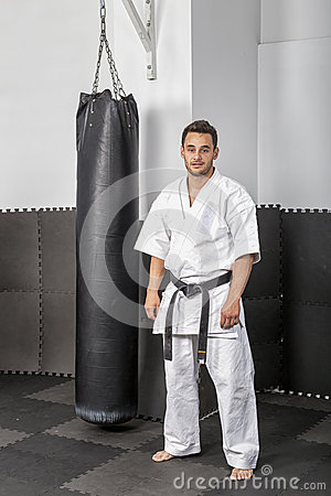 Free Athletic Black Belt Karate Standing Next A Boxing Ba Royalty Free Stock Images - 60100459