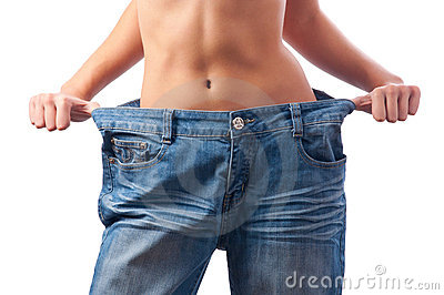 Athletic female body in too big trousers