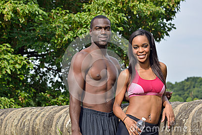 Athletic and fit African American couple - pausing during work-out