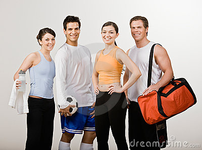 Athletic friends in sportswear with soccer ball