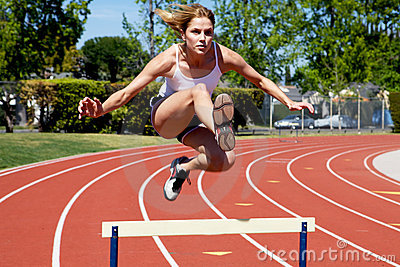Athletic girl hurdling