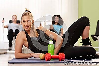 Athletic girl posing at health club
