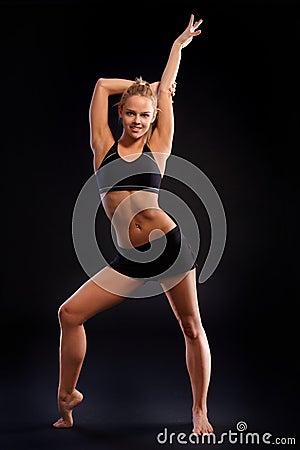 Athletic girl posing in sportswear