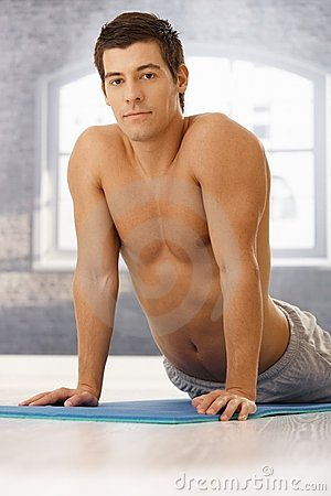 Athletic guy doing exercise