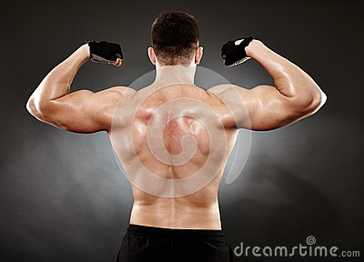 Athletic man doing bodybuilding moves for the back muscles