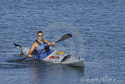 Athletic man in kayak
