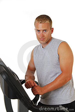 Athletic man resting on a treadmill