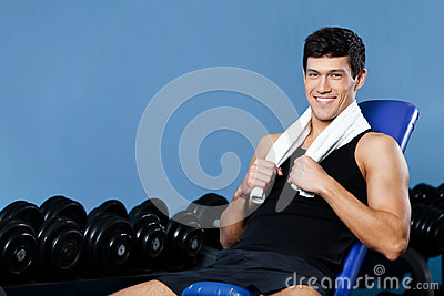 Athletic man rests in gym
