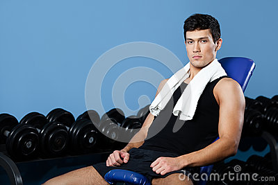 Athletic man rests in gym class
