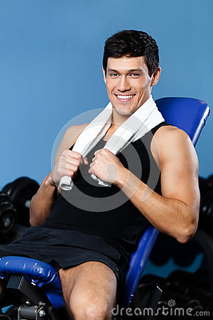 Athletic man rests in training gym