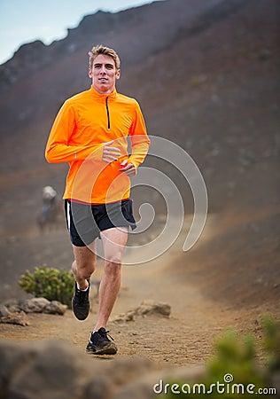 Athletic man running jogging outside, training