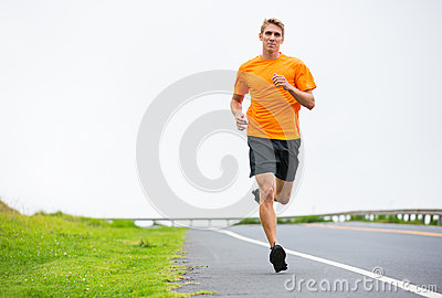 Athletic man running jogging outside