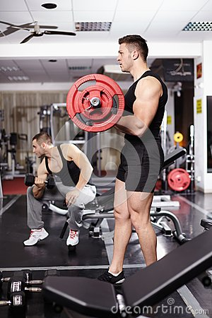 Athletic man working with barbell