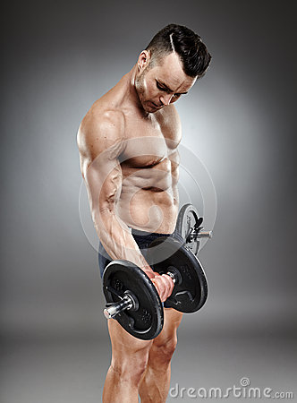 Athletic man working out with dumbbells