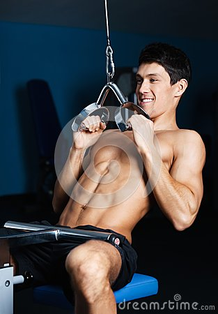 Athletic man works out on gym equipment