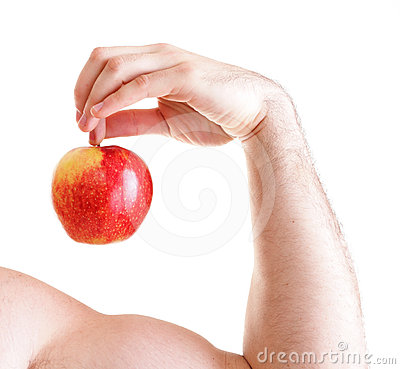 Athletic sexy male body builder holding red apple