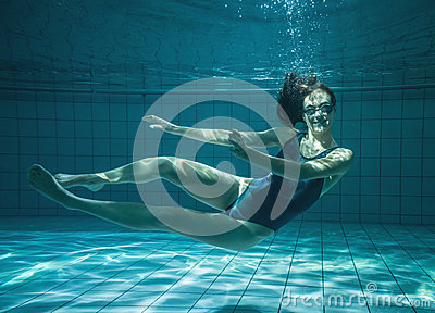 Athletic Swimmer Smiling At Camera Underwater Stock Photo Image 42559265