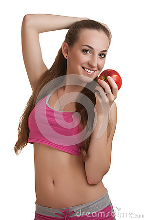 Athletic woman with apple