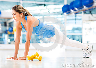 Athletic woman doing push-ups