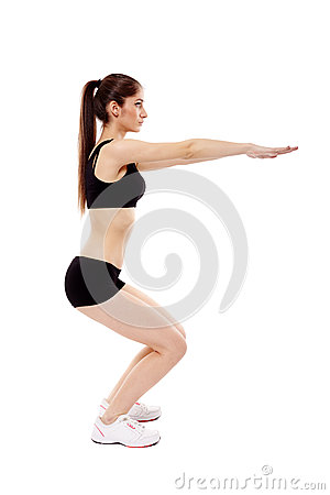 Athletic woman doing squats