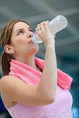Athletic woman driking water