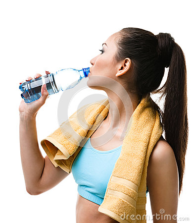 Athletic woman drinks water from the bottle
